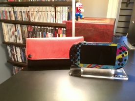A shot of my Vita, hanging out next to its case.